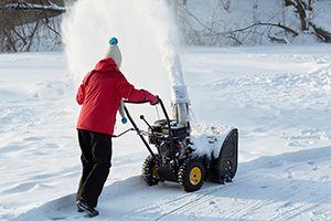 lady blowing snow
